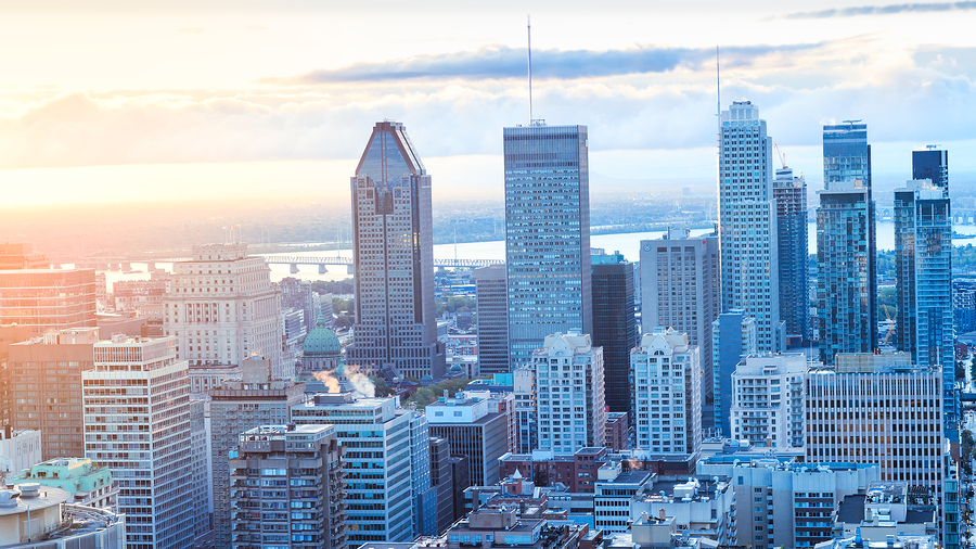 Montreal, CANADA - 29 September 2018. Montreal city at sunrise. Amazing view from Mont-Royal with colorful blue buildings. Stunning panorama of Montreal downtown skyline in the fall morning.